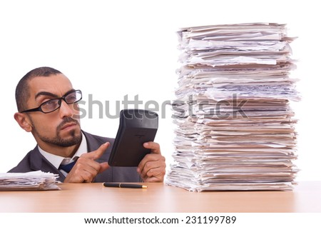 Angry businessman with stack of papers