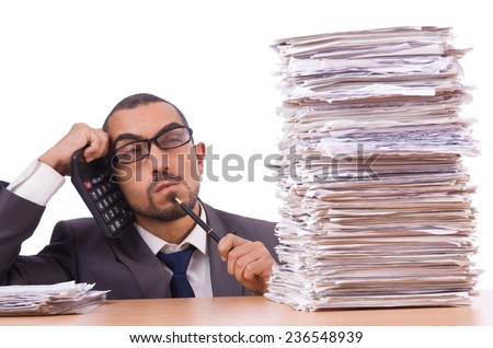 Angry businessman with stack of papers - stock photo