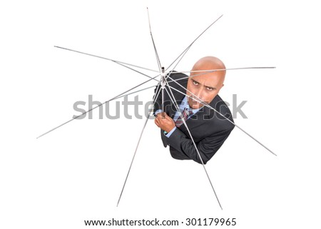 Angry businessman with umbrella frame isolated in white - stock photo