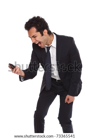 Angry businessman yelling at his phone from despair - stock photo
