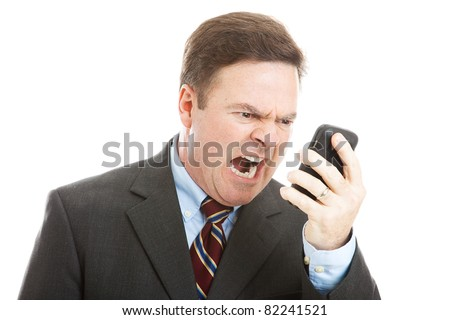 Angry businessman yelling into a cellphone.  Isolated on white. - stock photo