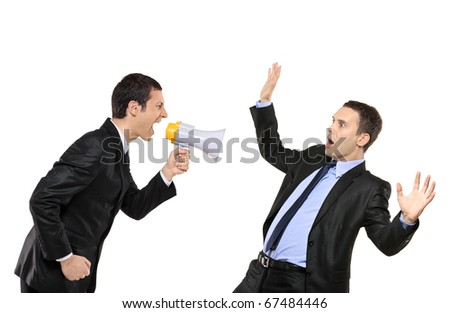 Angry businessman yelling via megaphone to another businessman isolated against white background - stock photo