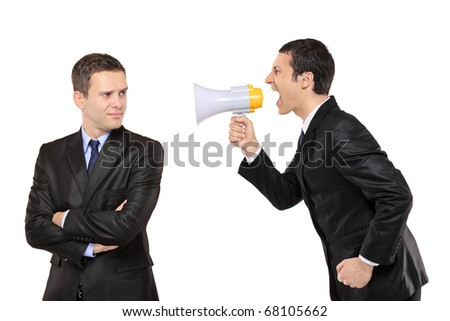 Angry businessman yelling via megaphone to another man isolated on white background - stock photo
