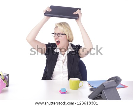 Angry businesswoman about to throw her laptop - stock photo
