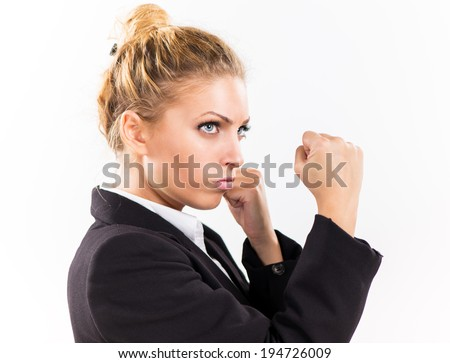 Angry Businesswoman boxing punching ready to fight.