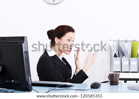 Angry businesswoman in office yellig on phone