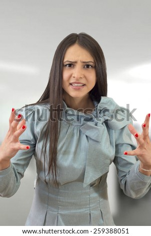 angry businesswoman in the office - stock photo