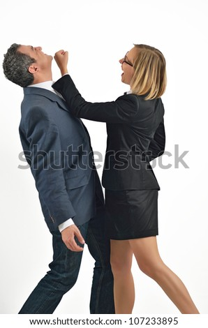 Angry businesswoman is hitting the businessman - stock photo