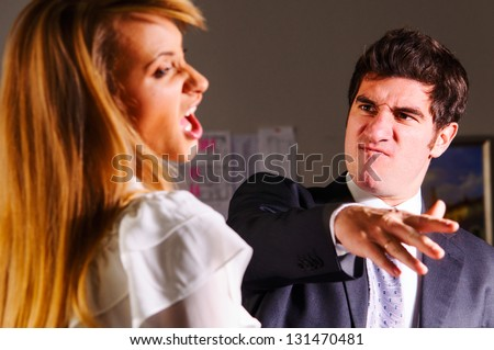 angry businesswoman is slapping across the businessman's face - stock photo