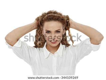 Angry businesswoman pulling her hair, isolated on white - stock photo