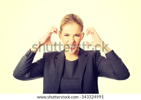 Angry businesswoman pulling her head. - stock photo
