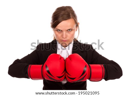 Angry businesswoman punching red boxing gloves together ready to fight isolated on white background  - stock photo
