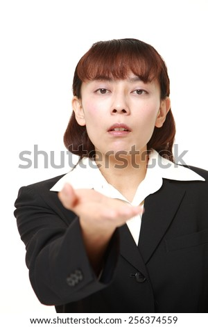 angry businesswoman requests something - stock photo
