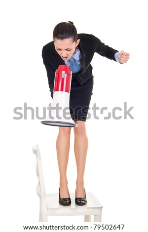 angry businesswoman shouting through megaphone on employers, standing on chair, isolated on white background - stock photo