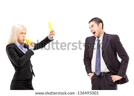 Angry businesswoman showing a yellow card to a businessman shouting, isolated on white background - stock photo