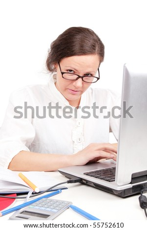 Angry businesswoman sitting in office with laptop