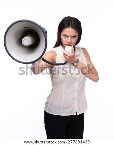 Angry businesswoman standing with megaphone over white background and looking at camera