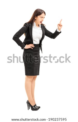 Angry businesswoman threatening with finger isolated on white background - stock photo