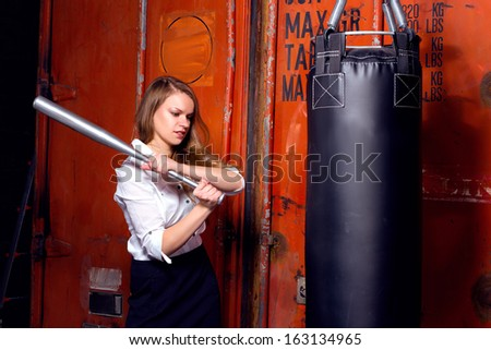 Angry businesswoman with boxing gloves - stock photo