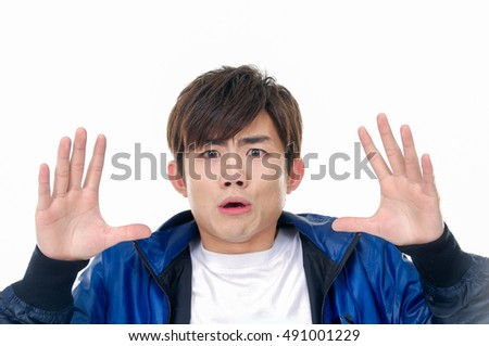 Angry casual man screaming isolated on a white background