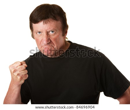 Angry Caucasian man with clenched fist over white background