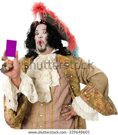 Angry Caucasian man with medium black hair in costume holding business card - Isolated - stock photo