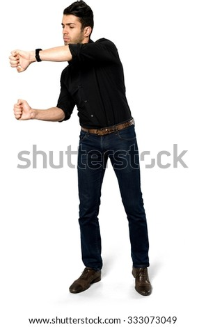 Angry Caucasian man with short black hair in casual outfit holding invisible object - Isolated