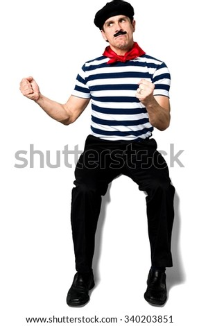 Angry Caucasian man with short black hair in costume shaking fist - Isolated - stock photo