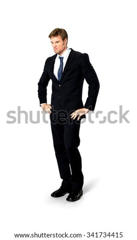 Angry Caucasian man with short medium blond hair in business formal outfit with hands on hips - Isolated