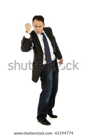 Angry caucasian middle aged businessman wearing handcuffs on a hand. Clenched fist. Studio shot. White background - stock photo
