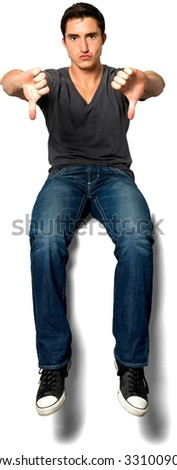 Angry Caucasian young man with short black hair in casual outfit giving thumbs down - Isolated - stock photo