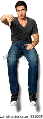 Angry Caucasian young man with short black hair in casual outfit with hands on thighs - Isolated - stock photo