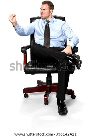 Angry Caucasian young man with short medium brown hair in business formal outfit with hands on thighs - Isolated