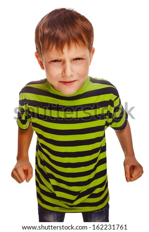 angry child boy blond bully bad aggressive fights in striped green shirt isolated  - stock photo