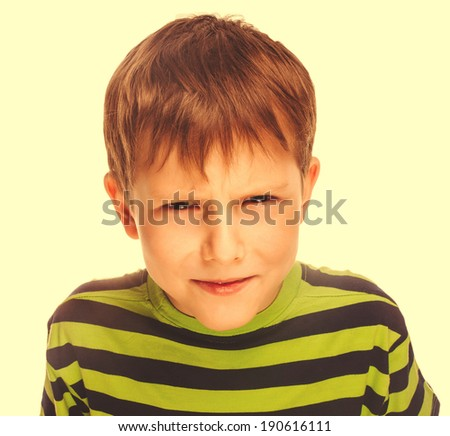 angry child boy blond bully bad aggressive fights in striped green shirt isolated large cross processing retro - stock photo
