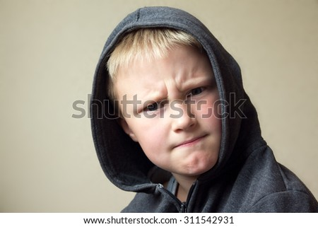 Angry child (boy, kid) portrait  - stock photo