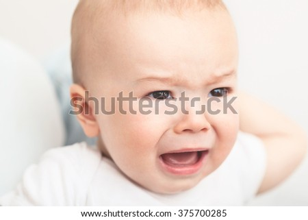 Angry child, frustrated and sad. - stock photo