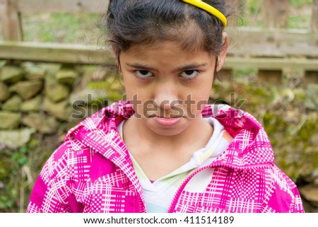 Angry child girl expression closeup portrait - stock photo