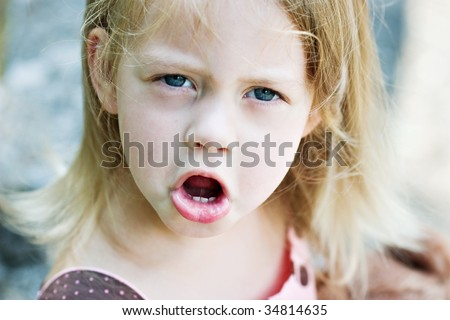Angry child having a tantrum. - stock photo