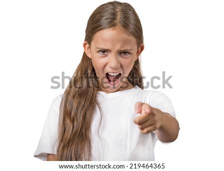 Angry child teenager girl screaming pointing finger at you demanding blaming isolated white background. Negative human emotion facial expression body language attitude perception. Scandal situation - stock photo