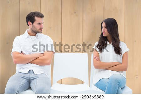Angry couple not talking after argument against wooden planks - stock photo