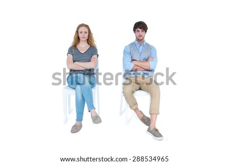 Angry couple not talking after argument on white background - stock photo