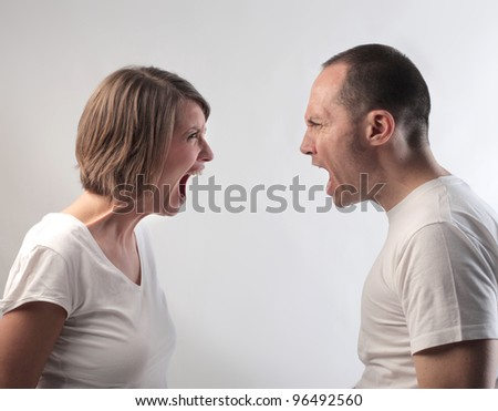 Angry couple screaming against each other