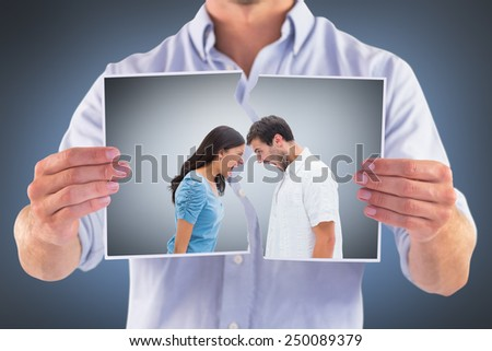 Angry couple shouting at each other against grey vignette