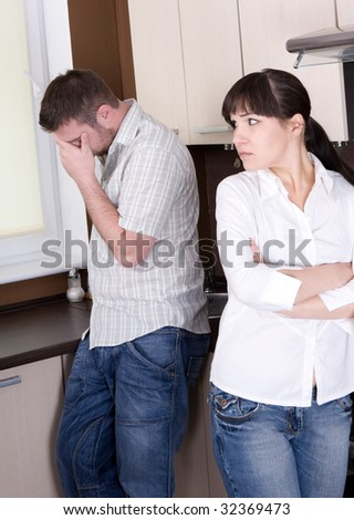 angry couple with problems in kitchen - stock photo