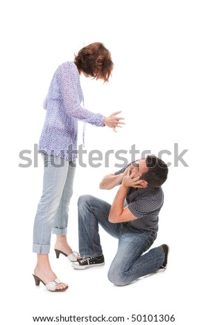 Angry couple yelling at each other  isolated over white background - stock photo