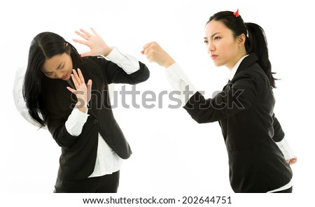 Angry devil side of a young Asian businesswoman punching the white angel isolated on white background