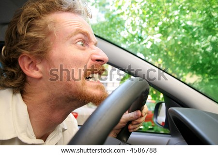 angry driver in the car - stock photo