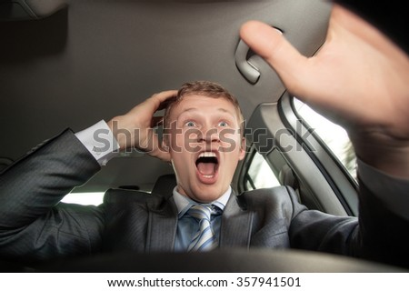 Angry driver on the road driving a car