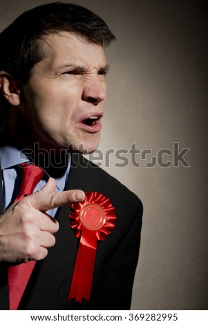 Angry Election Candidate Pointing Finger - stock photo